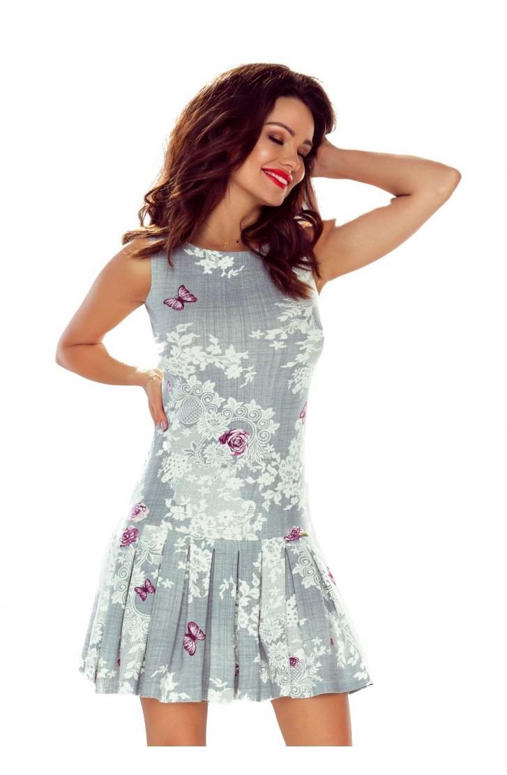 Elegancka dziewczęca sukienka z plisowanym dołem