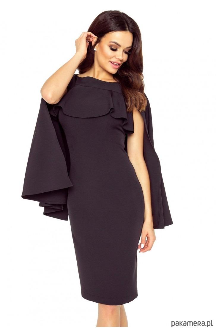 Wspaniała sukienka z baskinką i peleryną